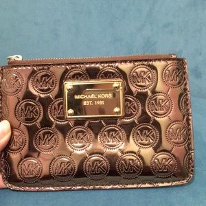 Michael Kors metallic brown wristlet.
